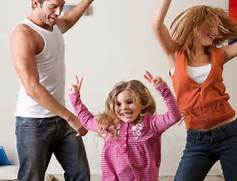 parents and toddler dancing